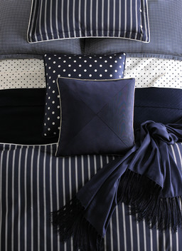 Bedding Photography: Overhead view of Ralph Lauren navy and white striped dot bedding photographed for Neiman Marcus catalog cover.