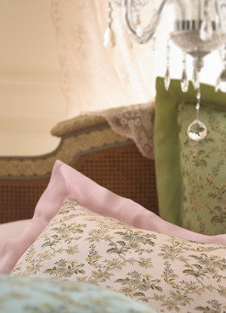 Bedding Photography: Cover photo for Neiman Marcus pink sale. Close-up of three pillows with part of chandelier in compostion.