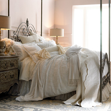 Bedding Photography: Luxurious looking shabby chic bedding photographed on metal poster bed.