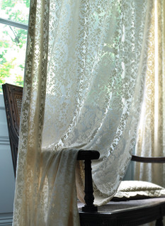 Window Drapery Photography: Dramatic view of sheer patterned drapery draped over chair arm for Horchow.