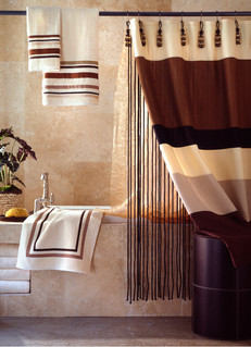 Shower Curtain Photography: Draped striped towels and bath mat hanging in stone bathroom with coordinating striped shower curtain.
