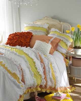Bedding Photography: Girl's bedding photo for Neiman Marcus of whie, red, and yellow checkered bedding with matching pillows.