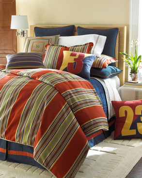 Bedding Photography: Red striped duvet with an assortment of pillows on bed for boy's room for Horchow.