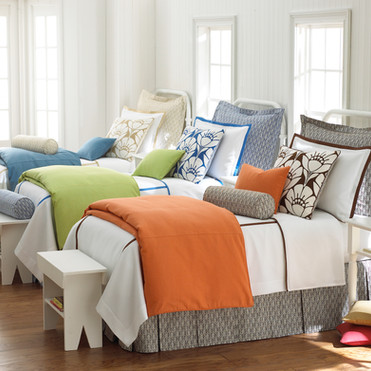 Bedding Photography: Three twin beds lined up to showcase the three colors the duvet is made in; Orange, Green, and Blue.