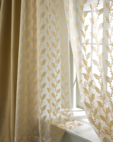 Drapery Photography: Soft lighting coming through window with gold leaf patterned sheer drapes.