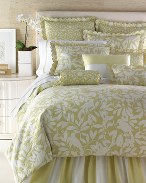 Bedding Photography: Foot view of Horchow green and white bedding with bird and leaf pattern. Scallopped flanged pillows and green striped border sheets on bed.