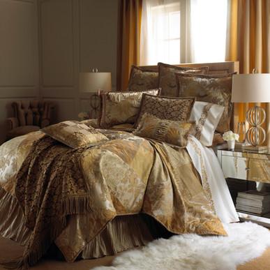 Bedding Photography: Luxurious gold bedding ensemble with 9 pillows.