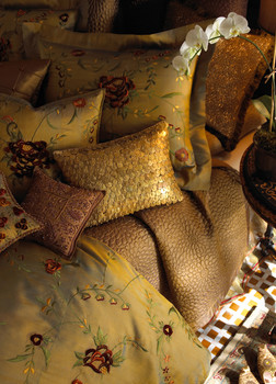 Bedding Photography: Overhead view of fancy shiny gold bedding lit moody for Neiman Marcus.