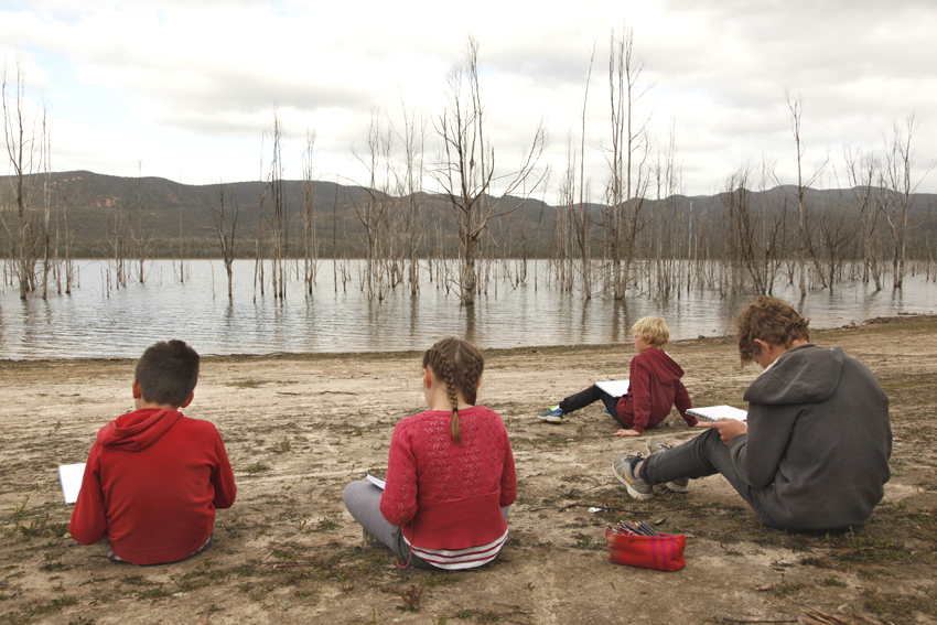 Children drawing in the environment