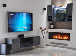 TV wall with bar and fireplace