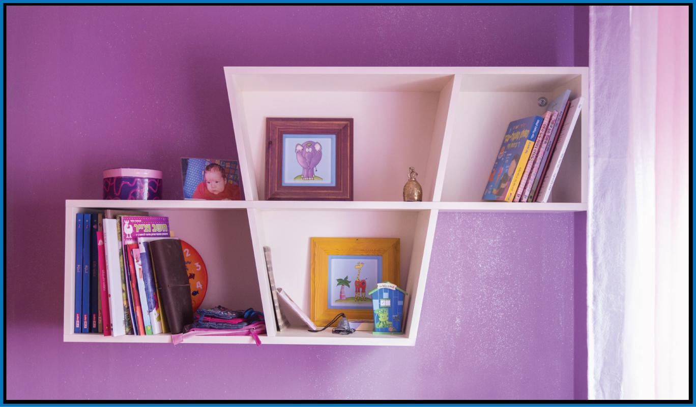 Wooden shelf on wallpaper wall