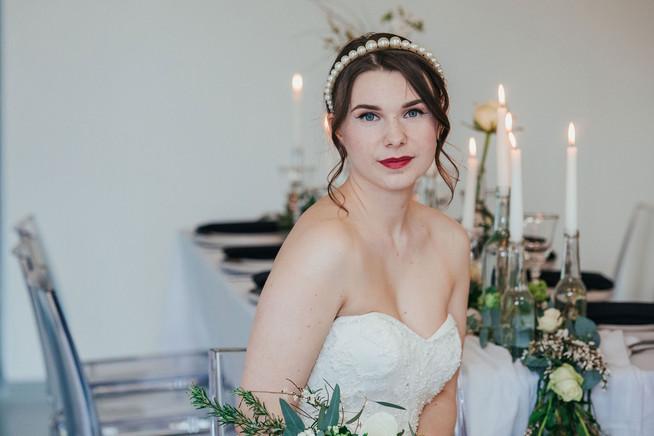 Creative, natural bridal makeup with bold lip and simple wedding hair