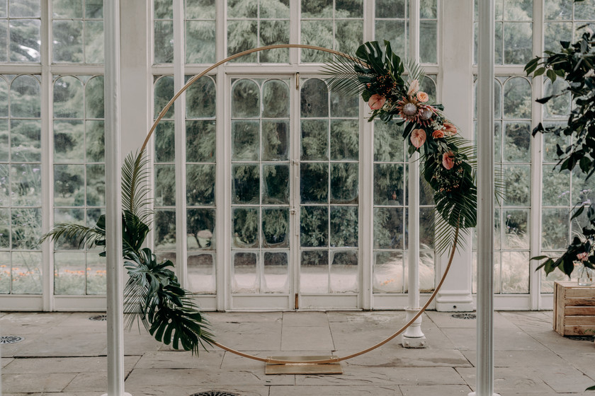 Tropical inspired wedding, moon gate and floral decor