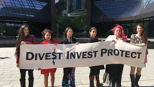 Representatives of the Spring 2018 Indigenous Women's Divestment Delegation to Europe, in Germany outside of Deutsche Bank