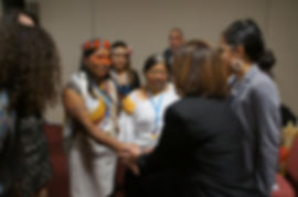 Keynote speaker Her Excellency Hilda Heine, President of the Marshall Islands, meets Alicia Cahuiya and Blanca Chancosa, Indigenous women defenders of Ecuador, at the start of the event
