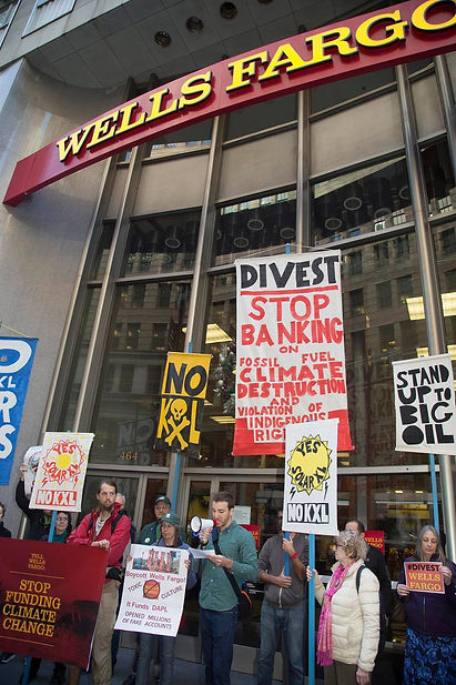 Standing for fossil fuel divestment at the Wells Fargo headquarters in San Francisco. WECAN Executive Director speaking at the action - Photos via Jane Richey