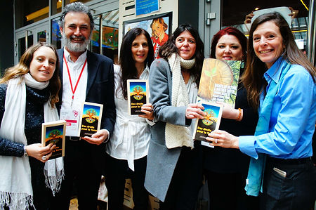 Members of the Global Alliance for the Rights of Nature, including Osprey Orielle Lake (WECAN), celebrate the publication of their book on Rights of Nature in Paris during COP21 climate negotiations.