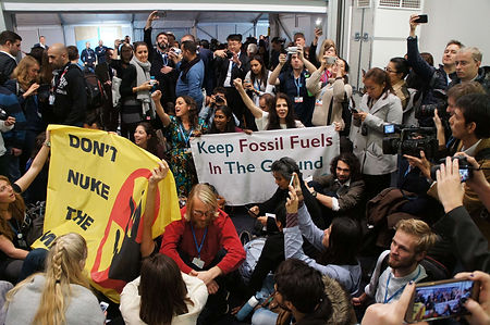 WECAN International Delegates participate with global allies in a direct-action to call-out false solutions from the Trump Administration at COP23