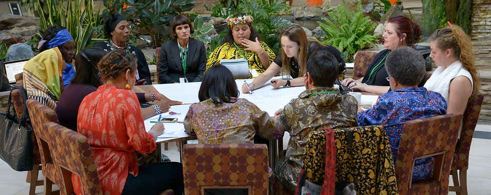 Global women leaders strategize together at WECAN's founding Summit - Photo via Lori Waselchuk