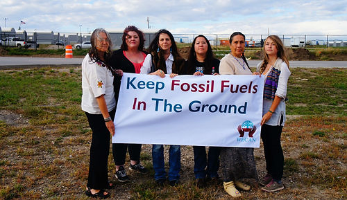 Members of the WECAN International team stand in solidarity with allies from the Indigenous Environmental Network and Movement Rights, in front of a man camp in North Dakota