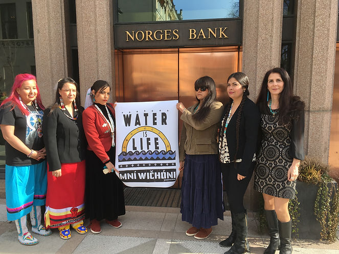 Indigenous Women's Divestment Delegation to Norway and Switzerland outside of Norges Bank before a meeting