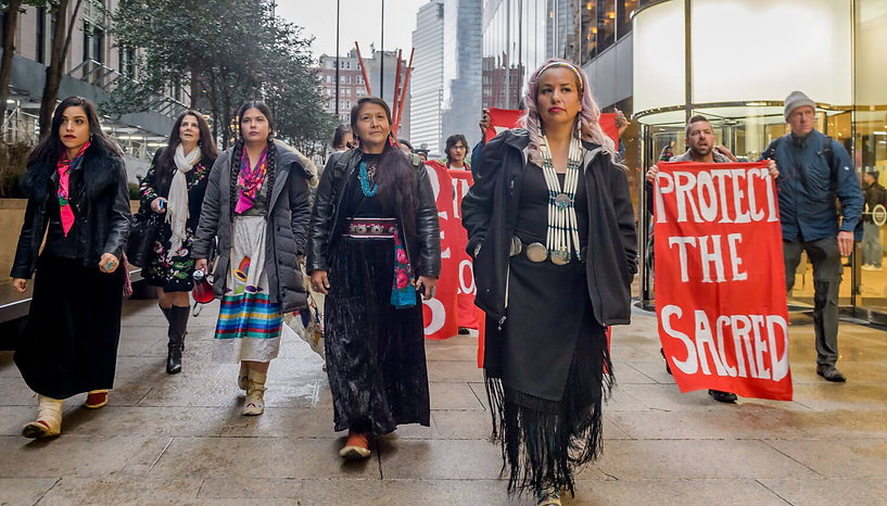 Indigenous Women's Divestment Delegation members prepare for action outside  Chase bank in New York City - Photo via Erik McGregor