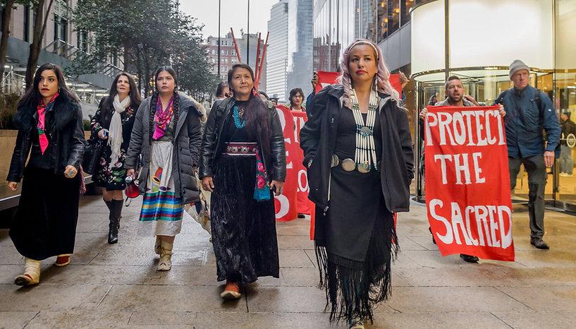 Indigenous Women's Divestment Delegation members prepare for action outside  Chase bank in New York City - Photo via Erik McGregor