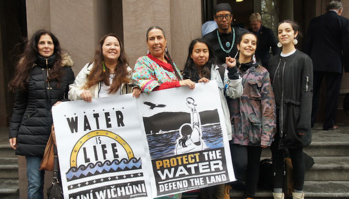 Following a CitiBank Divest action in NYC - Indigenous organizers including Kandi Mossett, Casey Camp Horinek, and Aru Apaza stand together with allies