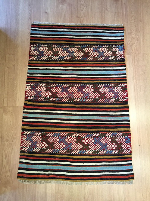 Small kilim with bright colors.