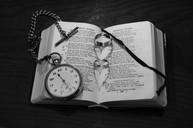 Pocket watch on bible