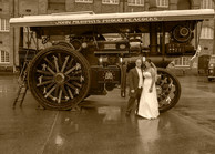 Sepia wedding photo with steam engine