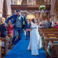 We did it! Groom jumps for joy