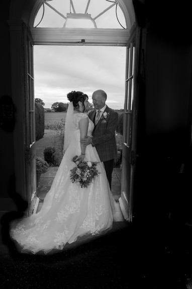 Wedding couple in doorway