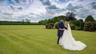 Bride and groom at Alrewas Hayes, Staffordshire. Stunning sky and landscape