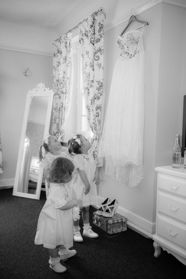 Cute - tiny bridesmaids looking at wedding dress