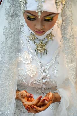 Beautiful Indonesian bride dressed in tr