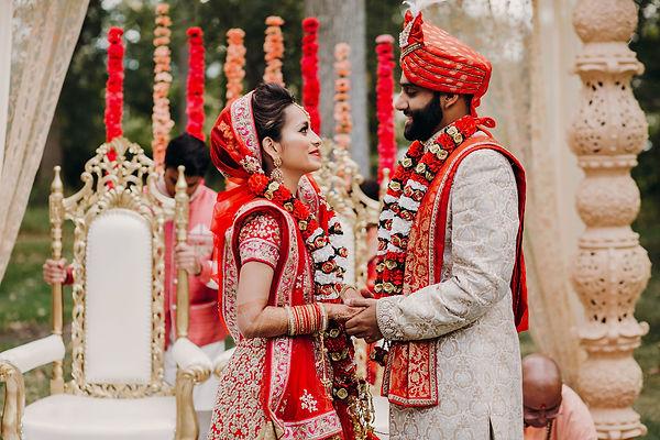 Indian groom dressed in white Sherwani a