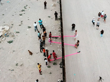 Ronald Rael installs pink seesaws on US-Mexico border wall