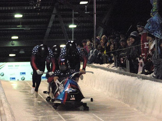 Holcomb debuts BMW four-person sled, finishes fourth in Whistler bobsled World Cup