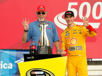 Phil Kurze of Bo-Dyn Bobsled Project Inc with Joey Logano in Victory lane in Charlotte after Logano&