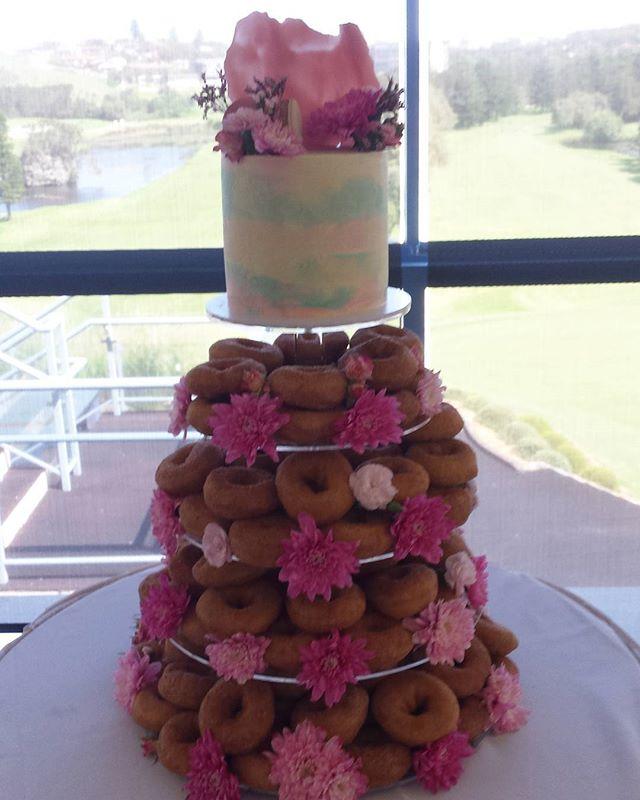 One of today's orders...a doughnut wedding tower! #cakesbyheidi.com