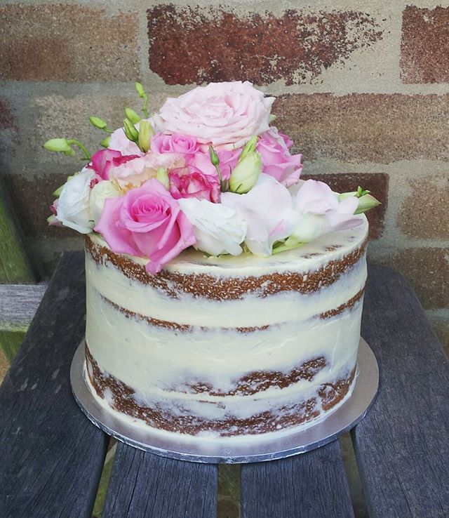 Lemon and coconut semi naked cake 🌹🌹🌹 #sydneycakes #nakedcake #seminakedcake #pinkroses #80thbirt