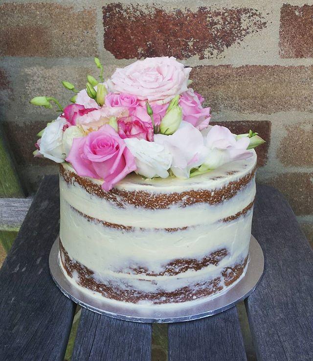 Lemon and coconut semi naked cake 🌹🌹🌹 #sydneycakes #nakedcake #seminakedcake #pinkroses #80thbirt