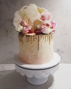 Golden drip strawberry cake with watercolour marble buttercream finish, white chocolate and gold sai