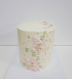 Simple but pretty painted buttercream flowers on this strawberry birthday cake for one of my favouri
