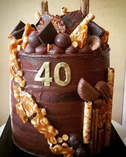 Chocolate, peanut butter and salted caramel cake with semi naked finish