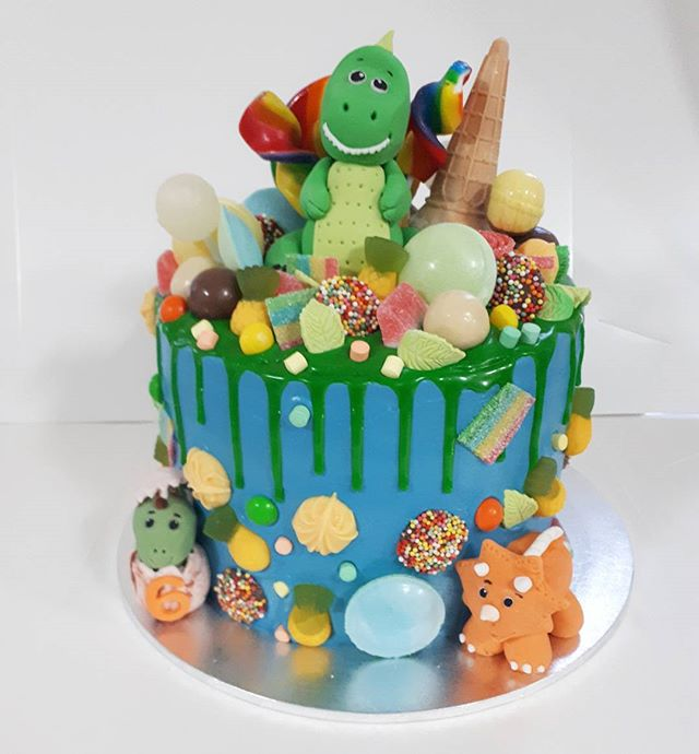 Last order for the weekend. Cute dinosaur chocolate cake loaded with lollies