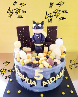 Batman's back and this time he is trapped in a city of lollies