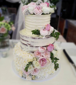 Ali & Jeremy's wedding cake! I loved this cake with its coconut ruffles, semi naked and full butterc