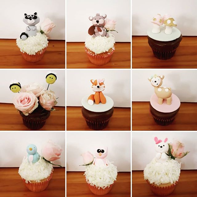 This was such a cute baby shower theme! Woodlands animal cupcakes with the prettiest fresh pink rose